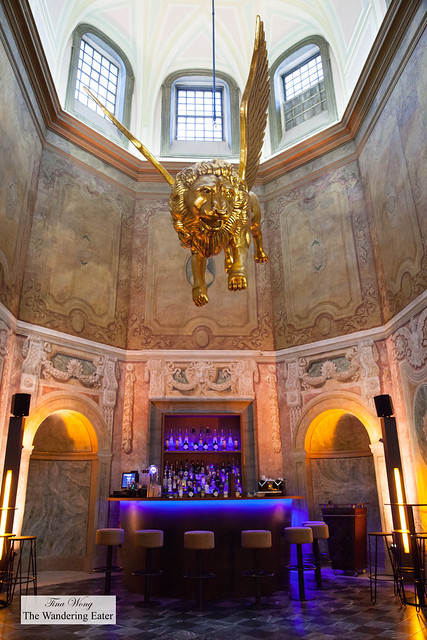 Golden winged lion sculpture hanging overthe second floor bar