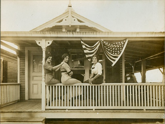 Women with flags on porch
