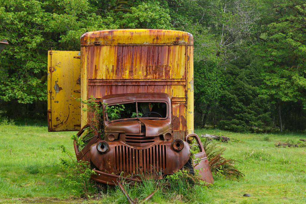 An old moving van is wet with rain in the Quinault Rain Forest