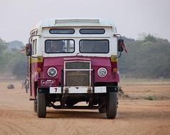 Old bus running on rural road in Bagan, Myanmar