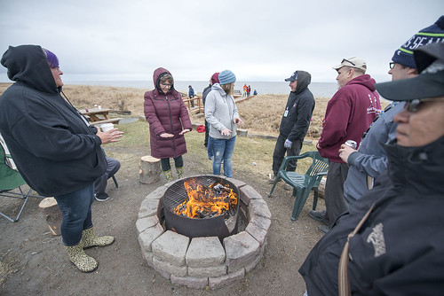 The fire was a popular stop during the opening of the net on May 1. The day featured a brisk breeze and intermittent rain.