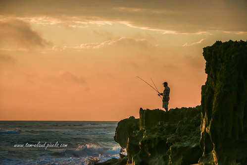 sly orange orangesky clouds cloudy weather morning sunrise earlymorning fishing fisherman rocks ocean sea water atlantic atlanticocean seascape seaside island hutchinsonisland nature mothernature stuart florida usaoutdoors outside