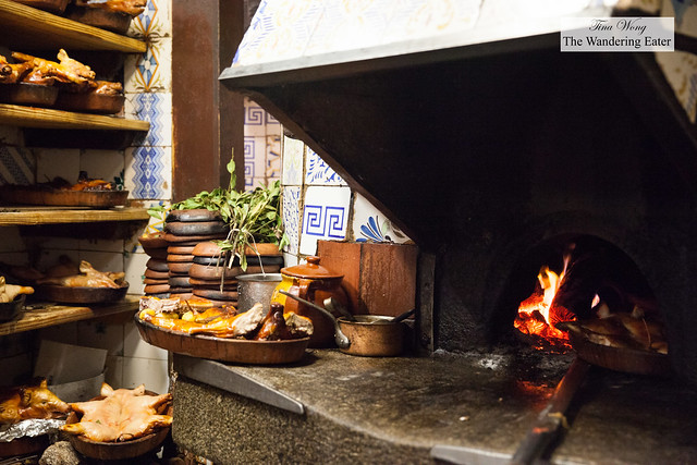 The kitchen devoted to roasting the suckling pigs and lamb