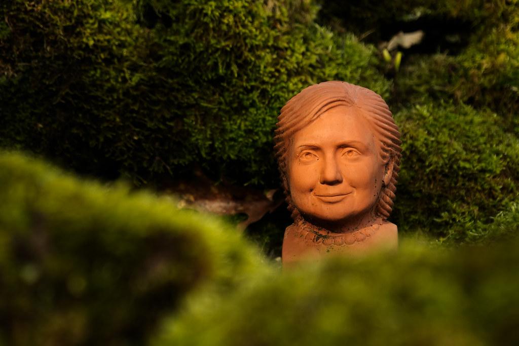 A sculpture of Hillary Clinton in a garden in Portland, Oregon