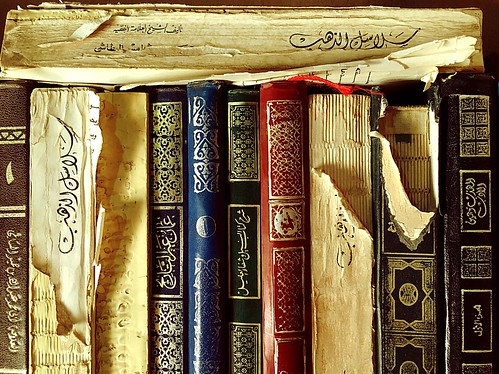 age wisdom books oman nizwa fort colorful pages yellow gild