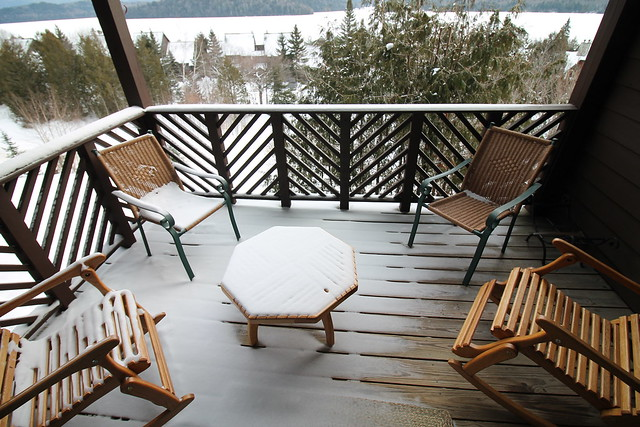 Covered balcony overlooking the lake and mountains;