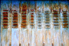 Rusted blue shutters