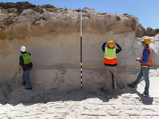 Archeologists inspect excavation