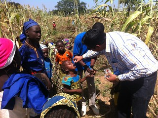 Administering vaccine on a farm in Nigeria