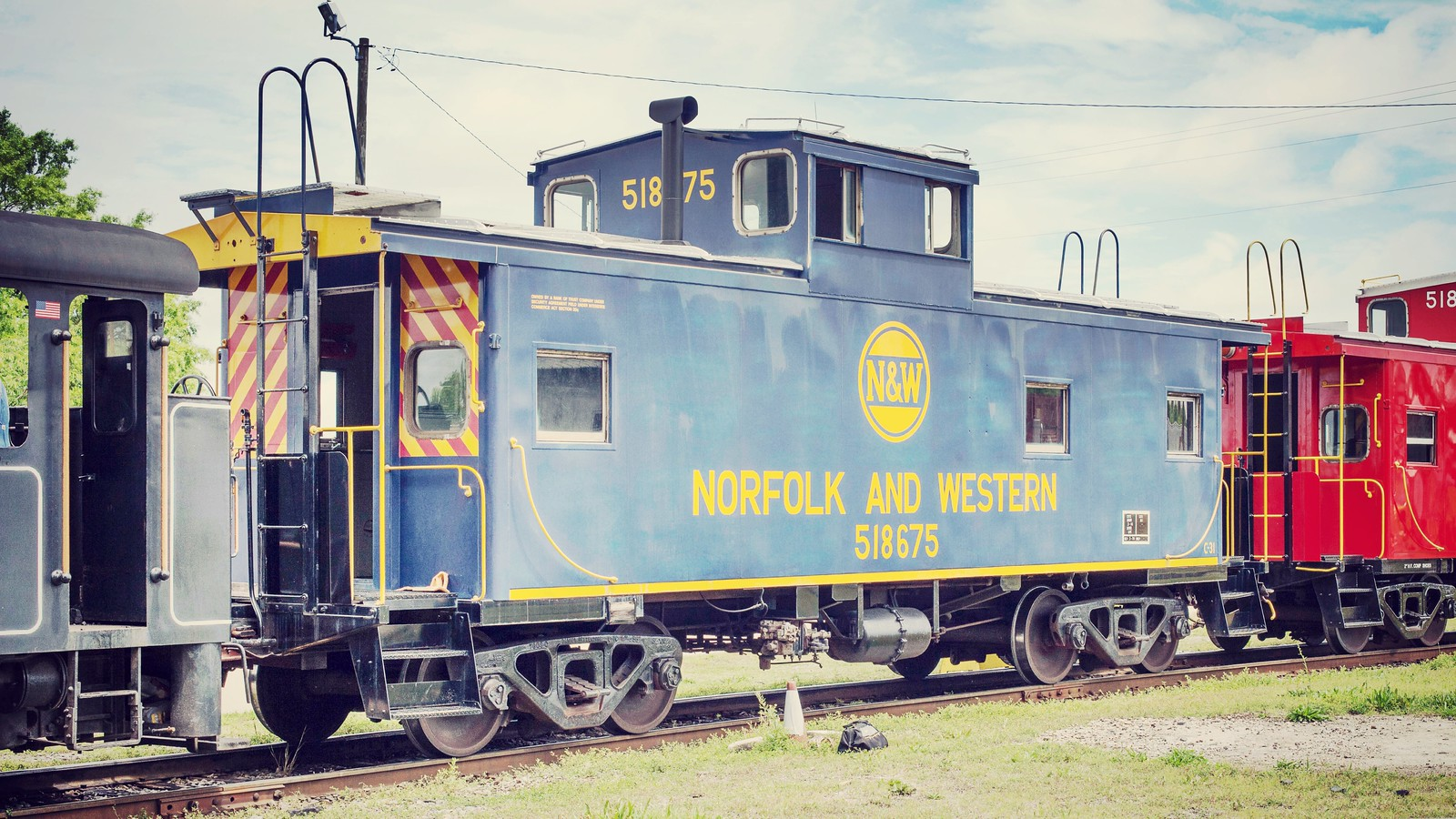 The North Carolina Transportation Museum (NCTM) offered Caboose rides around the campus throughout the day of May 13, 2017 in celebration of National Train Day - N&W Caboose 518675 was first in line.