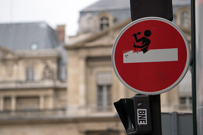 Clet Abraham no entry sign hack near The Louvre, street art, Paris