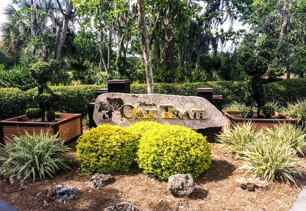Oak Trail sign and topiaries