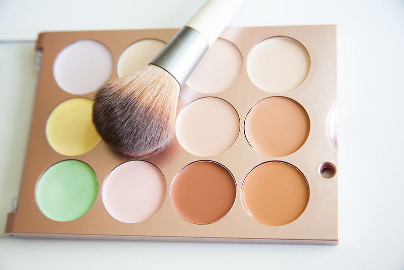 colorful makeup palette with brush