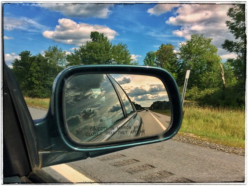 roadtrip maine sideviewmirror reflection clouds objectsinmirrorarecloserthantheyappear snapseed landscape roadside