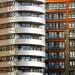 Silver apartment building by Jan van der Wolf