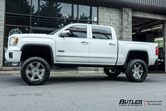 GMC Sierra with 24in Amani Forged Verato Wheels and Nitto Mud Grappler Tires with 8in Fabtech Lift 2