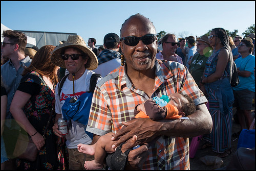 Spy Boy Al holding his grandson during Jazz Fest day 6 on May 6, 2017. Photo by Ryan Hodgson-Rigsbee www.rhrphoto.com