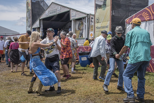 Dancing at the Fais Do Do Stage, Jazz Fest 2017. Photo by Marc PoKempner.
