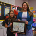 "Rep. Stephanie Cummings and Generali School 5th grader Natalie Alamo with her winning poster on the theme, ""My Favorite Place to Read in Waterbury."""