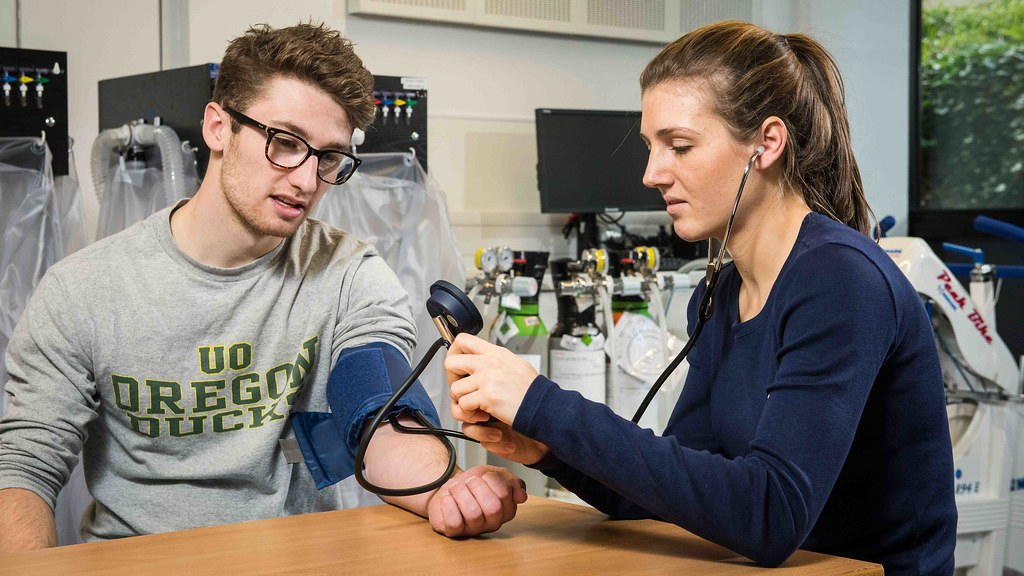 A student takes the blood pressure of another student