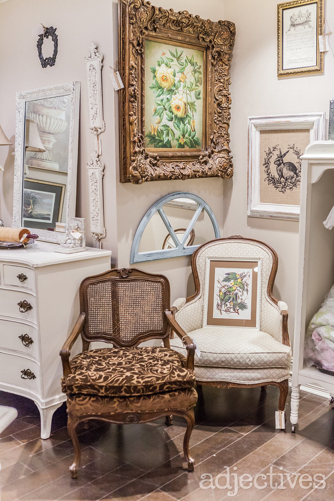 Vintage upholstered chairs and vintage wall art at Adjectives Winter Park by The Vintage Nest