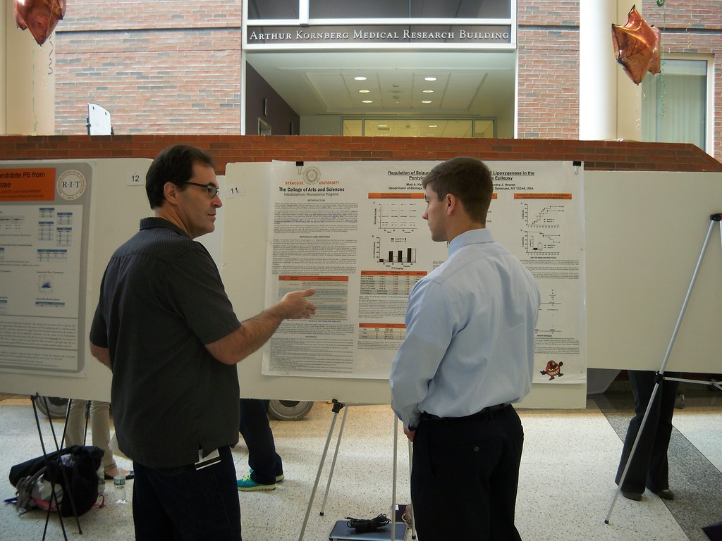 Chris Proschel discussing poster with Syracuse Undergrad
