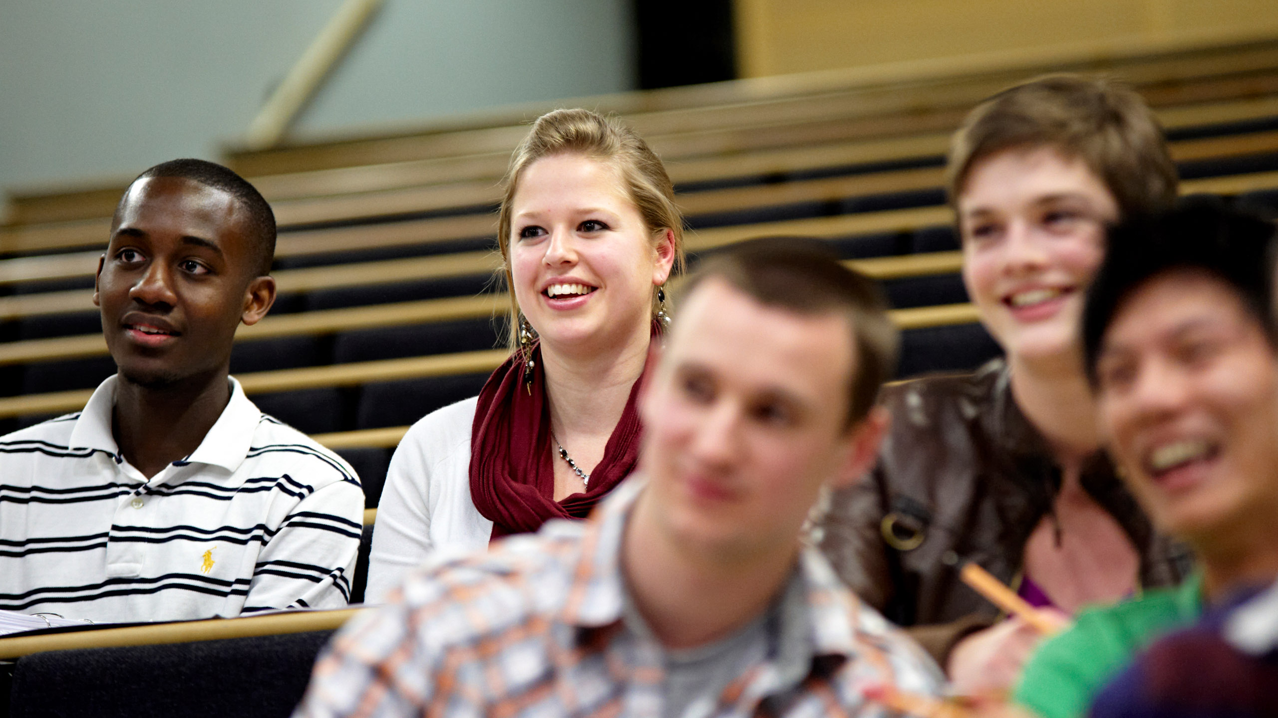 Students laughing in a lecture hall