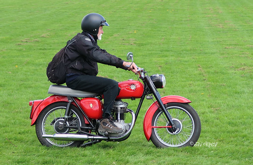 A man on an old British motorcycle