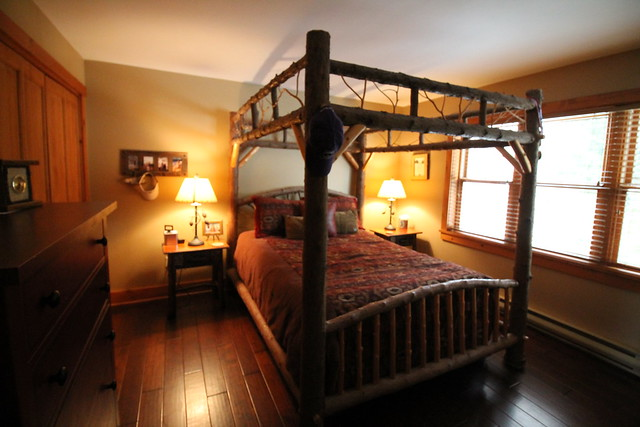 Hand crafted master king size bed, hardwood floors and Adirondack decor;