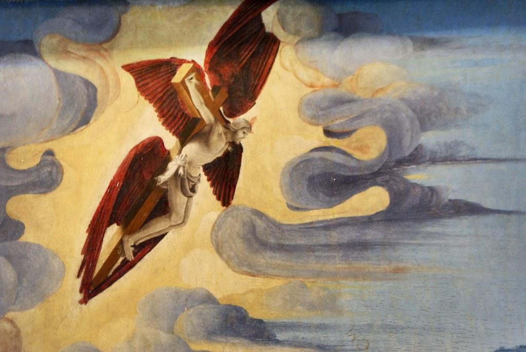 Image insolite : Jésus sur sa croix avec des ailes dans un tableau de la galerie Saubada de Turin.