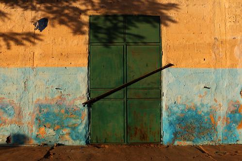 door wall house street urban podor senegal africa shadow town village