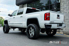 GMC Sierra with 24in Amani Forged Verato Wheels and Nitto Mud Grappler Tires with 8in Fabtech Lift 3