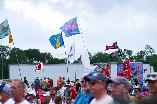 Audience and flags. Saturday, April 29, 2017 - Jazz Fest Day 2. Photo by Eli Mergel.