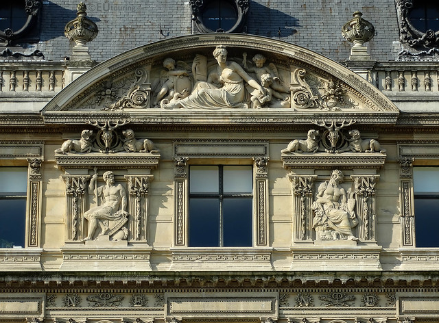 Details around windows of the Louvre