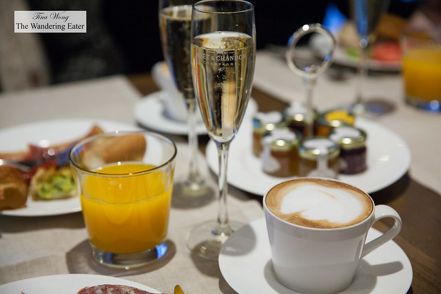 Orange juice, Moët & Chandon Champagne and cappuccino