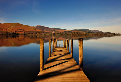 stretching out ashness derwent derwentwater jetty wooden posts wood boardwalk eastshore lake cumbria lakedistrict lakeland view scenic thelakes lakedistrictnationalpark nationaltrust fell fells cumbrian northwestengland mountains landscape imagestwiston district national park countryside mountain water morning spring blue cloudless englishlakedistrict lakes thelakedistrict bright sunlight sun sunshine wideangle wide angle tranquil serene serenity le longexposure 10stopnd pier catbells