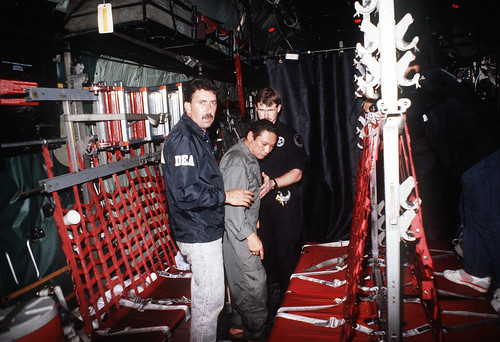 Noriega is escorted onto a U.S. Air Force, 1990