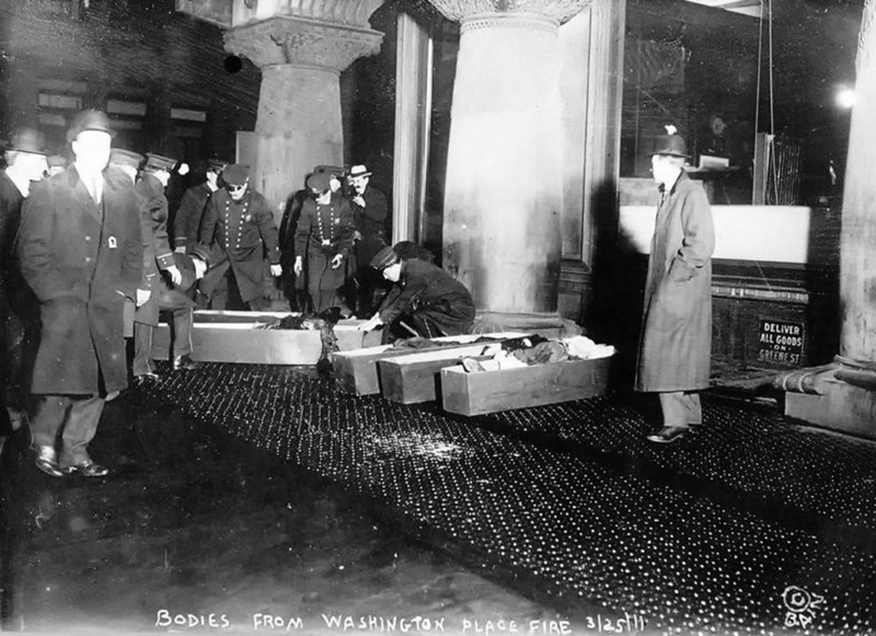 police or fire officials placing Triangle Shirtwaist Company fire victims in coffins