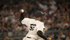 Yankees starter CC Sabathia delivers a pitch against the Red Sox in the sixth inning.