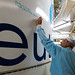 Christophe Duchêne (Eutelsat Director European Satellite Programmes) puts his signature on the Ariane 5 ECA launcher fairing (Kourou, French Guiana)