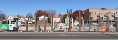 Autumnal streetscape with residences, H-piles, and dirtpiles.