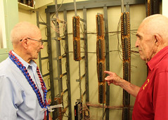 Col. John F. Miniclier, left, and Sgt. 1st Class Edgar R. Fox, both retired Marines who served at the Battle of Midway, examine a message routing switchboard during their tour of the former Station HYPO, June 2. (U.S. Navy/Justice Vannatta)