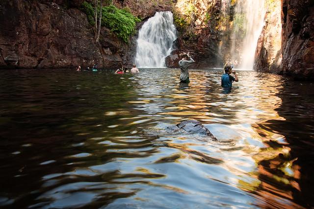 People enjoying a plunge at Florence Falls