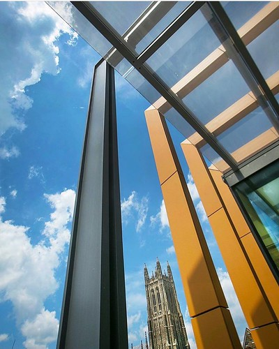 Modern meets gothic when the steel and glass of the Brodhead Center frame the Chapel as they both reach for the sky. #pictureduke #dukephotoaday #brodheadcenter Photo by @c_hildreth/Duke Photography.