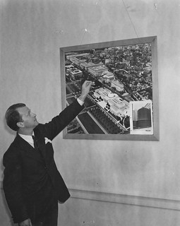 Photograph of Collas D. Harris Examining a Picture of the Federal Triangle Area of Washington DC