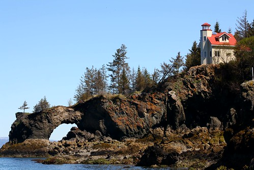 Lighthouse and natural arch