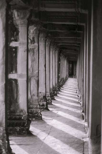 Shadows cast through a hallway in Angkor Wat, black and white
