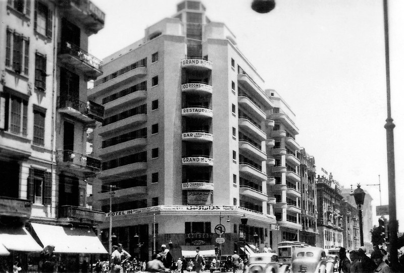 Jun 1941 - Allied troops & locals cross the busy intersection outside the Grand Hotel on Fouad 1st Street, central Cairo, Egypt - real photo post card - circa 1940