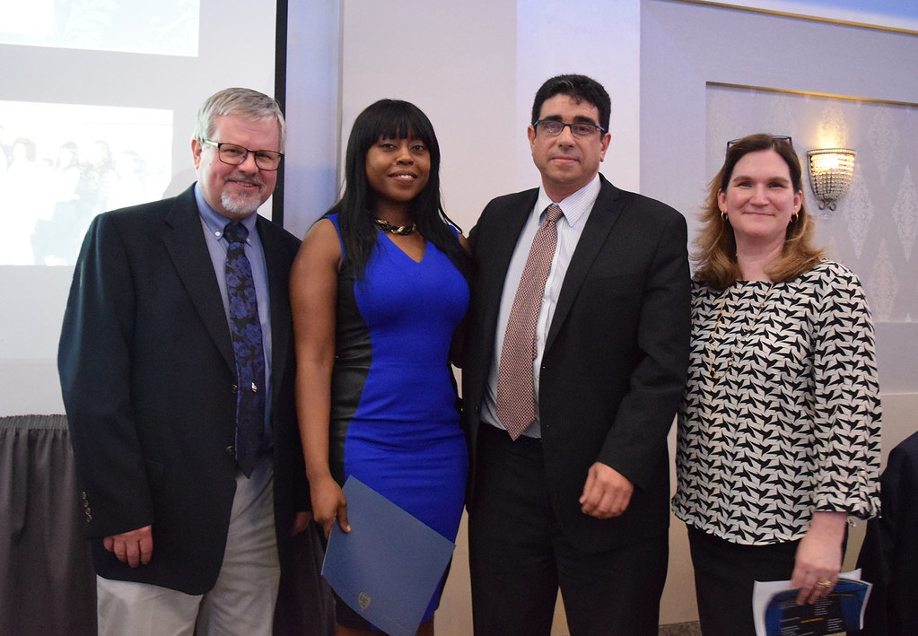 Graduating resident, Dr. Sachica Cheris (second from left) with Drs. Scott Kirkley, Luis De Las Casas, and Linda Schiffhauer.