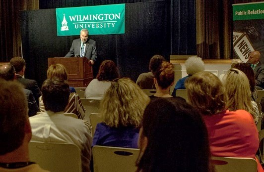 Dr. John Gray, dean, Wilmington University College of Education, speaks at a June 22 university press conference announcing the award of a $500,000 National Council for Teacher Residencies grant to the College of Education's year-long teacher residency program.